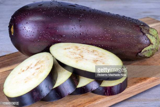 slices of eggplant on wooden background - eggplant stock pictures, royalty-free photos & images