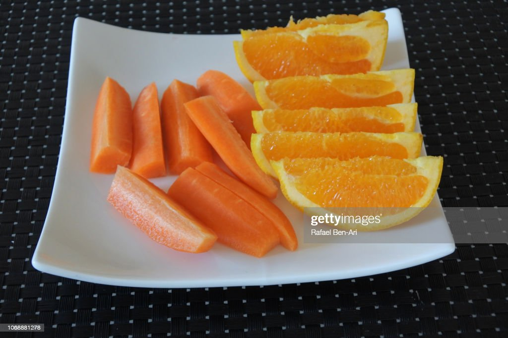 Slices of Fresh Ornage and Carrot : Stock Photo