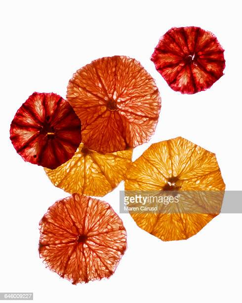 Slices of grapefruit on white background
