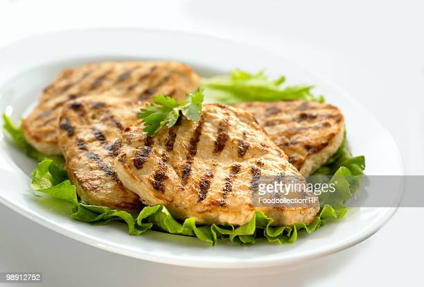 slices of grilled chicken breast, close-up