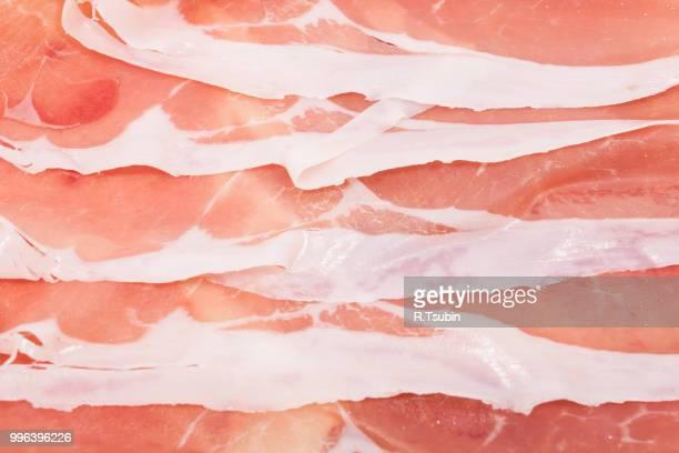 Slices of italian ham prosciutto crudo close-up