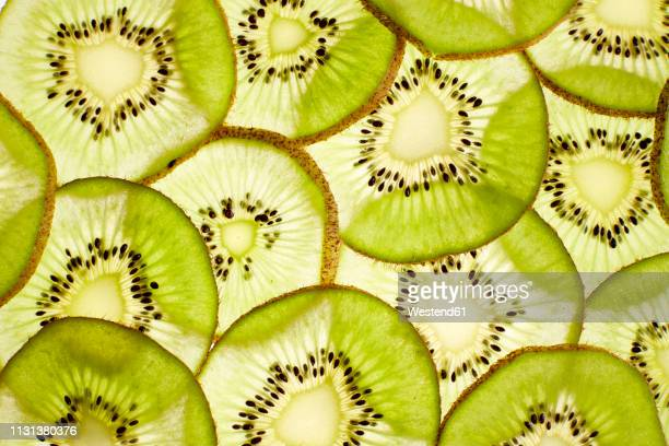 slices of kiwi, close-up - translucent stock pictures, royalty-free photos & images