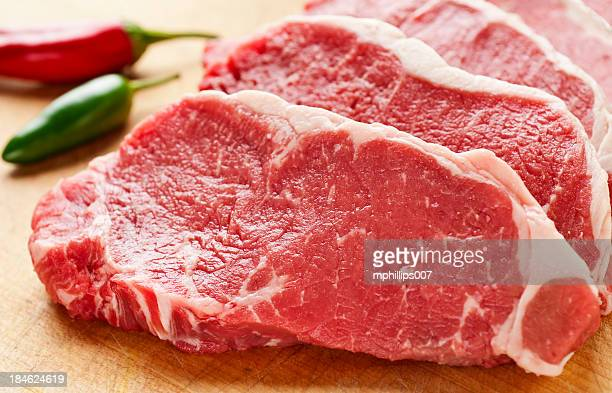 slices of new york strip steak on cutting board - meat stock pictures, royalty-free photos & images