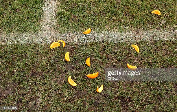 Slices of orange and studmarks are left next to the touchline of one of the Hackney Marshes football pitches on January 24 2010 in London England...