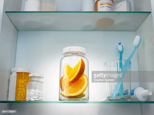 Slices of oranges in a pill bottle