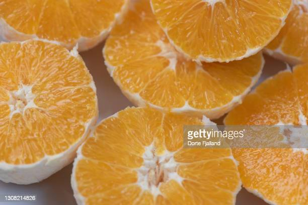 slices of peeled oranges - dorte fjalland fotografías e imágenes de stock