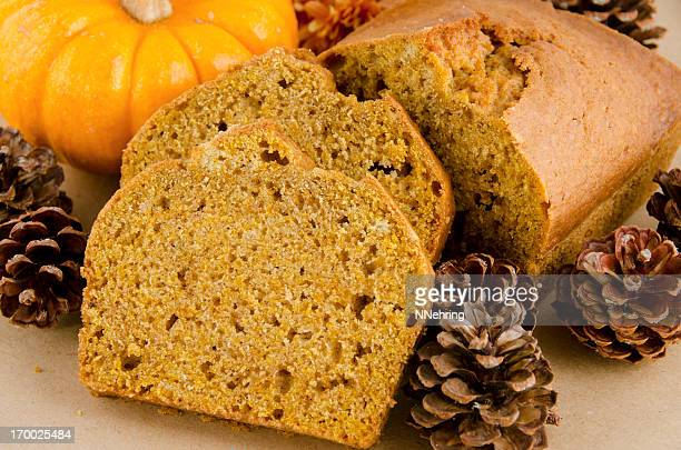 slices of pumpkin bread surrounded by pinecones