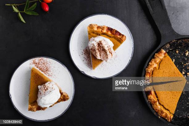 slices of pumpkin pie served on plate - dessert stock pictures, royalty-free photos & images