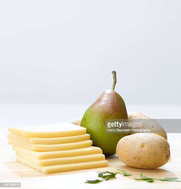 Slices of Raclette cheese, potatoes and pear