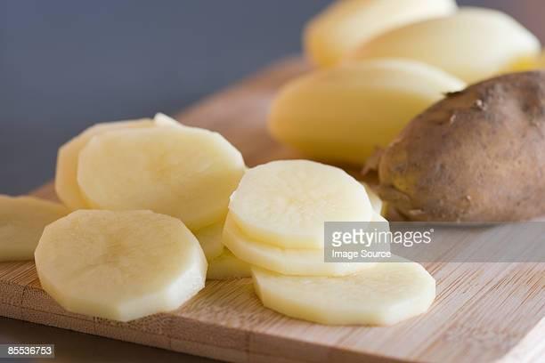 slices of raw potato - prepared potato stock pictures, royalty-free photos & images