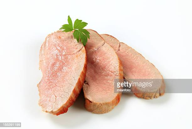 slices of roasted pork placed on a white background - pork stock pictures, royalty-free photos & images