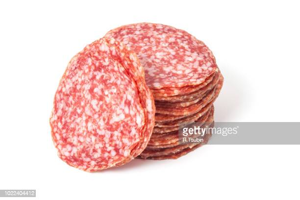 slices of salami isolated on a white background - salami stock pictures, royalty-free photos & images