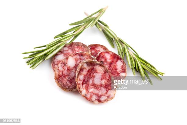 slices of salami isolated on a white background - chorizo stock pictures, royalty-free photos & images