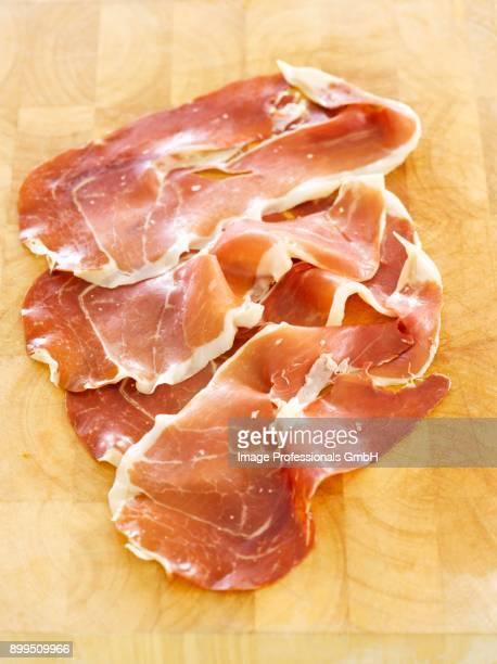 slices of serrano ham - serrano ham stock photos and pictures