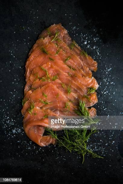 slices of smoked salmon with sea salt flakes and dill - salmone affumicato foto e immagini stock
