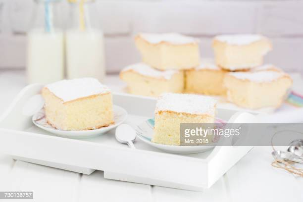 slices of sponge cake and bottles of milk - sponge cake stock pictures, royalty-free photos & images