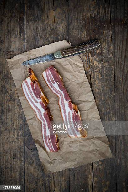 Slices of streaky bacon