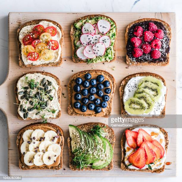 Slices of toast with a variety of healthy toppings