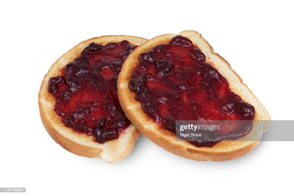 Slices of toast with raspberry jam jelly isolated on white with clipping path : Stock Photo