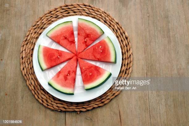 slices of water fresh and tasty melon fruit served in a plat - rafael ben ari bildbanksfoton och bilder