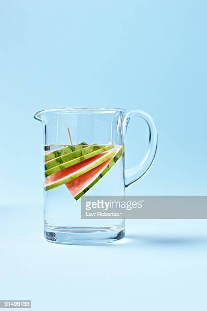 Slices of watermelon in pitcher of water