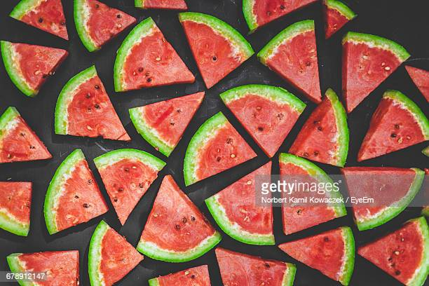 Slices Of Watermelon Over Black Background
