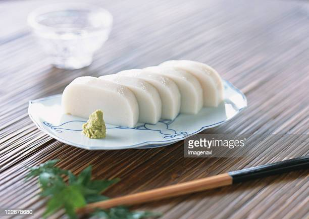 slices of white fish paste served with wasabi - wasabi paste stock pictures, royalty-free photos & images