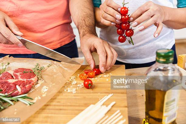 Slicing tomatoes on chopping board