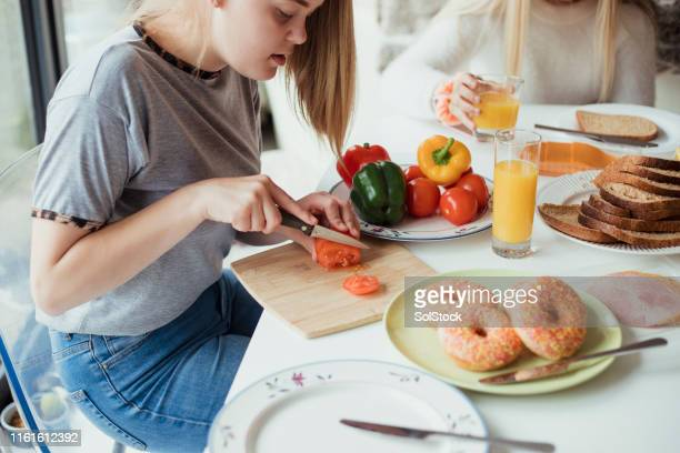 slicing tomatoes - preparation stock pictures, royalty-free photos & images