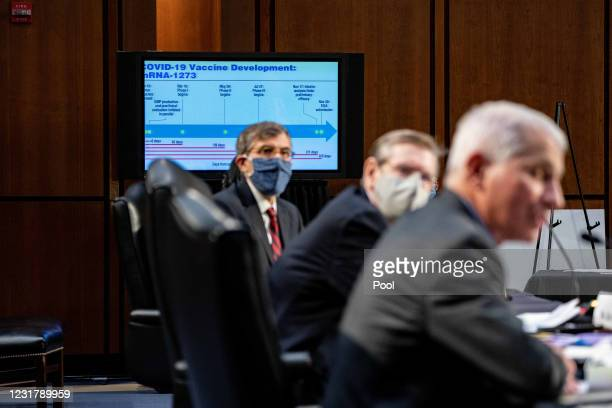 Slide is seen on a TV during a hearing with the Senate Committee on Health, Education, Labor, and Pensions, on the Covid-19 response, on Capitol Hill...