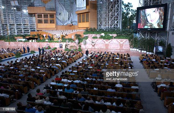 Slide presentation is shown during the funeral for 5 year old Samantha Runnion at the Crystal Cathedral on July 24, 2002 in Garden Grove, California....