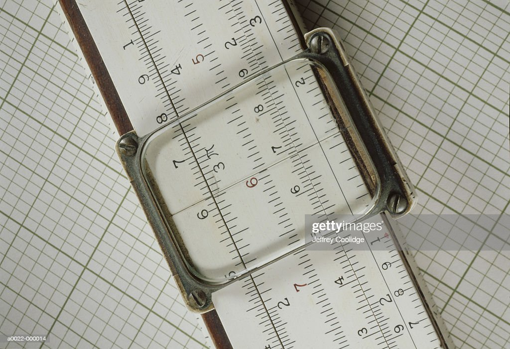 slide rule on graph paper stock photo getty images