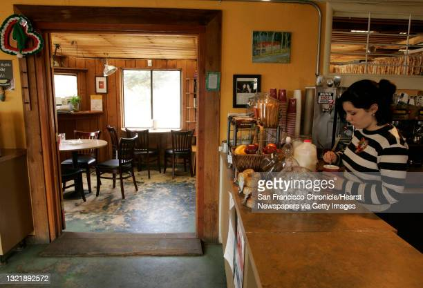 """Slide04_158_mac.jpg Holly Moffett was hired just two days ago at the """"Caffe Lucca"""" coffee shop in Montara, in anticipation of tomorrow's opening of..."""