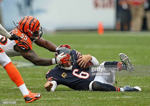 Sliding after running 18 yards for a first down Jay Cutler of the Chicago Bears is grabbed by the head by Vontaze Burfict of the Cincinnati Bengals...
