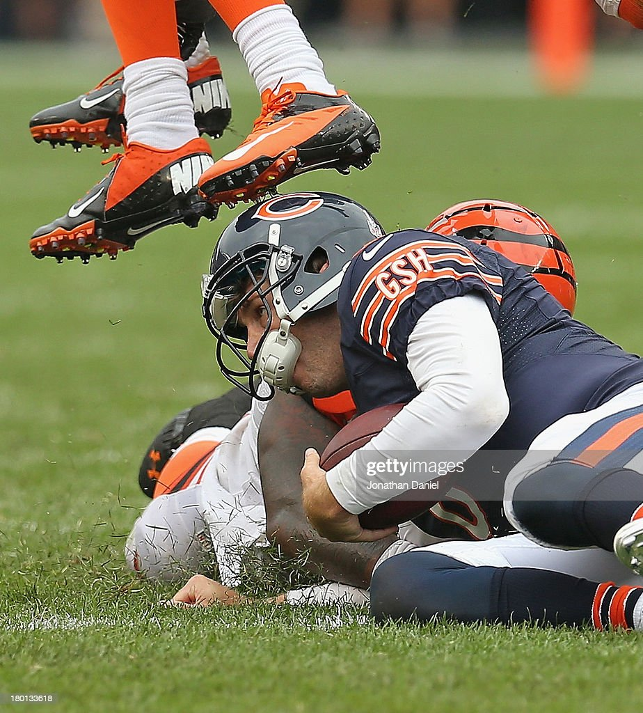 Sliding after running 18 yards for a first down, Jay Cutler #6 of the Chicago Bears is stepped on the head by a Cincinnati Bengal defender at Soldier Field on September 8, 2013 in Chicago, Illinois. The Bears defeated the Bengals 24-21.