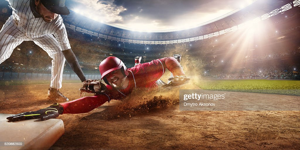 Sliding and tagging on third base : Stock Photo