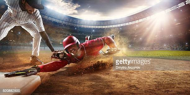sliding and tagging on third base - baseball sport stock pictures, royalty-free photos & images