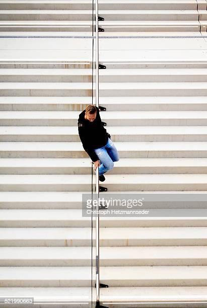 Sliding down a railing