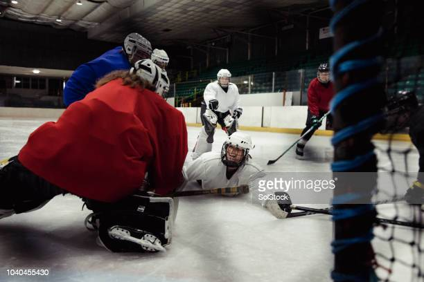 sliding in for the attack - ice hockey player stock pictures, royalty-free photos & images