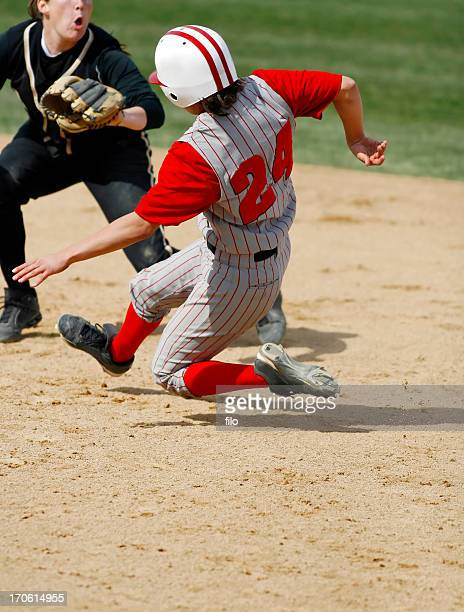 sliding into second base - softball sport stock pictures, royalty-free photos & images