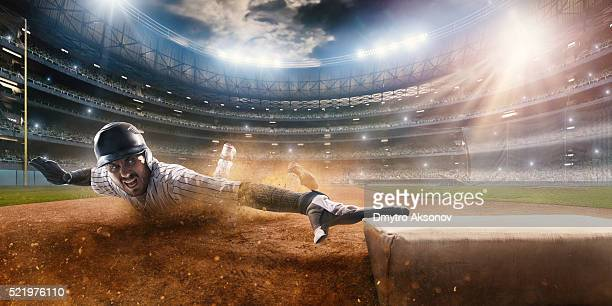 sliding on third base - baseball player stock pictures, royalty-free photos & images