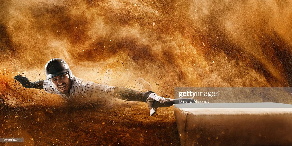 Sliding on third base : Stock Photo