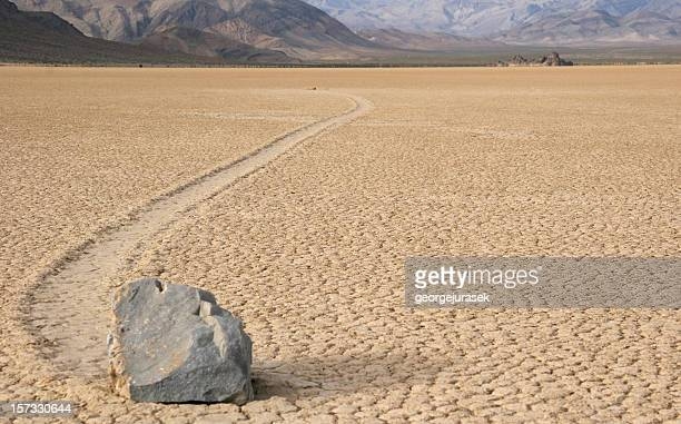 sliding rock paving a path through the desert - lake bed stock photos and pictures