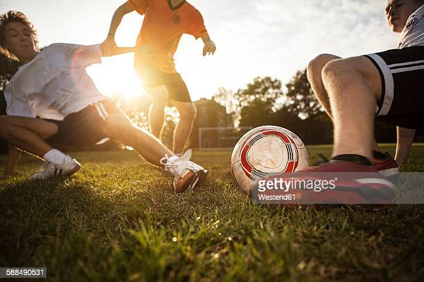 sliding tackle on soccer pitch - sportlicher zweikampf stock-fotos und bilder