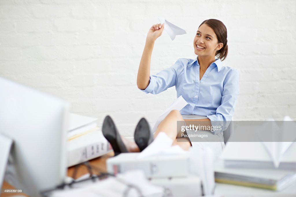 Slightly distracted at her desk : Stock Photo