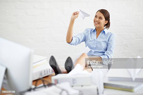 slightly distracted at her desk - wasting time stock pictures, royalty-free photos & images