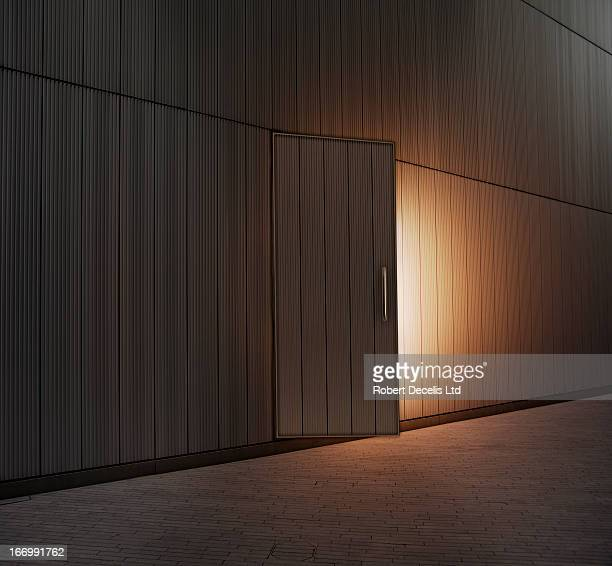 slightly open door lit from within - chance stock pictures, royalty-free photos & images
