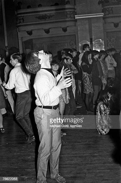 A slightly stoned fan watches the ceiling during a psychedelic rock concert at the Fillmore Auditorium in San Francisco California in early summer...