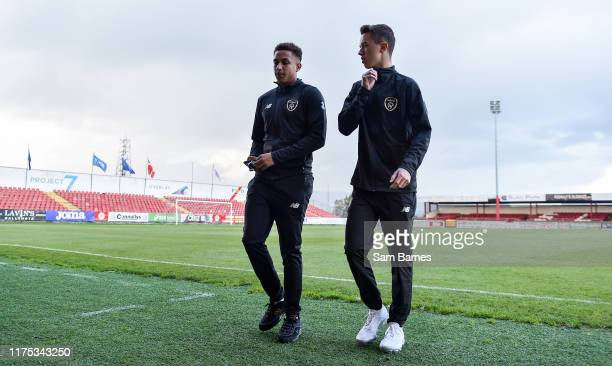 Sligo Ireland 11 October 2019 Republic of Ireland players Lewis Richards left and Harvey Neville leave the field following a pitch inspection ahead...