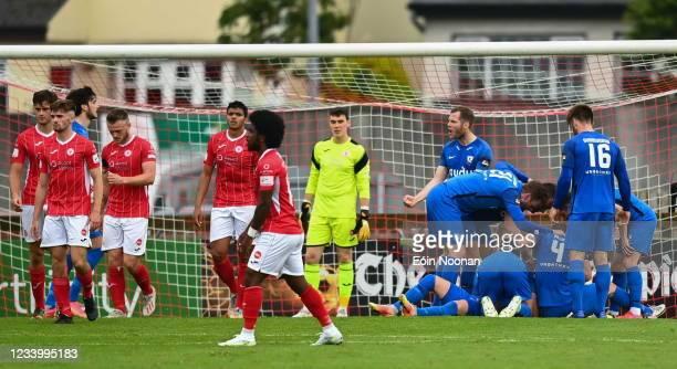 Sligo , Ireland - 15 July 2021; Steven Lennon of FH Hafnarfjordur, hidden, celebrates with team-mates after scoring his side's first goal during the...